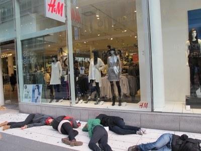 Activists faint outside H&M flagship store