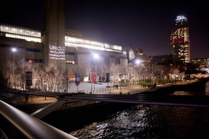 Projection on Tate Modern Calling Attention to UNIQLO's Disdain for Garment Workers