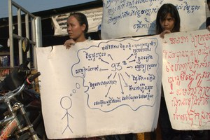 Workers outside E-garment factory in Cambodia call for an increase in the minimum wage
